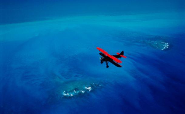 Red Waco Biplane over Key West, Florida keys National Marine Sanctuary