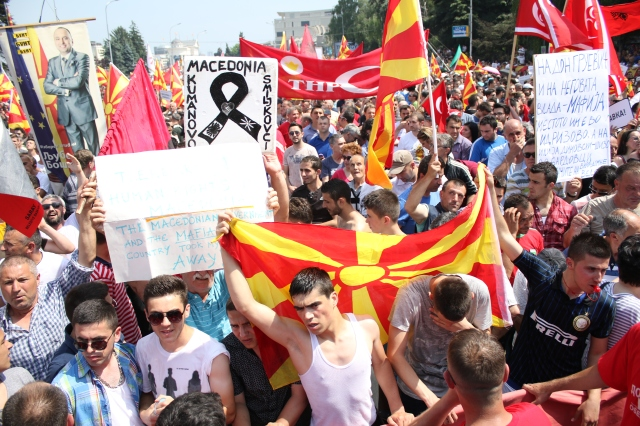 Skopje, Macedonia. 17th May 2015 -- Tens of thousands of protesters take to the streets of Macedonia's capital on Sunday, waving Macedonian and Albanian flags and calling for the government to resign. -- Tens of thousands of protesters took to the streets of Macedonia's capital on Sunday, waving Macedonian and Albanian flags in a dramatic display of ethnic unity and calling for the government to resign.